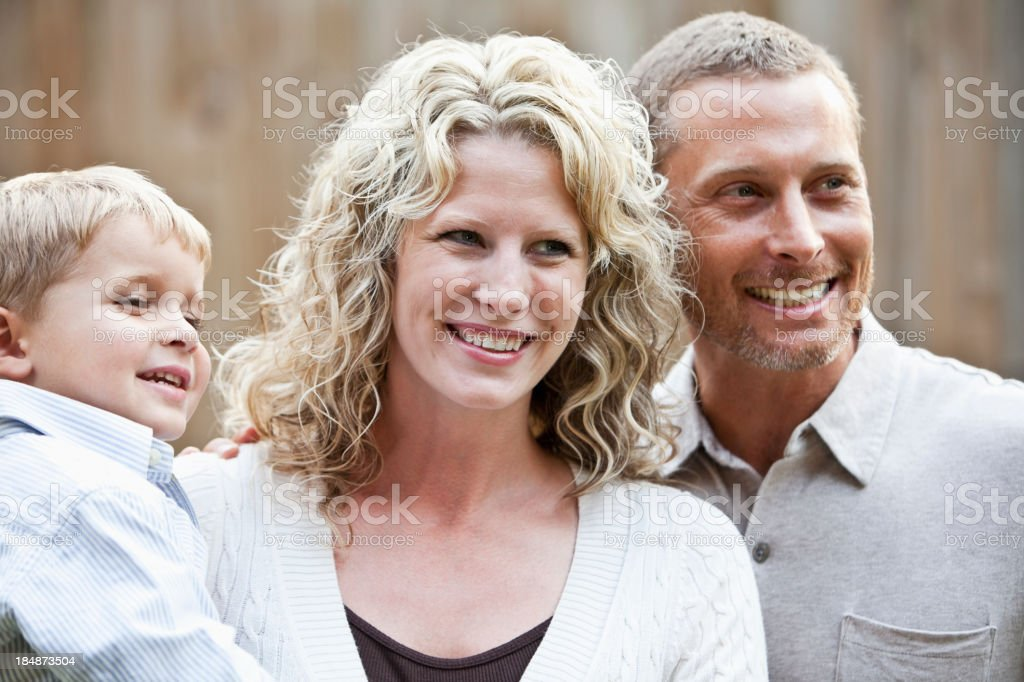 Happy family with little boy stock photo