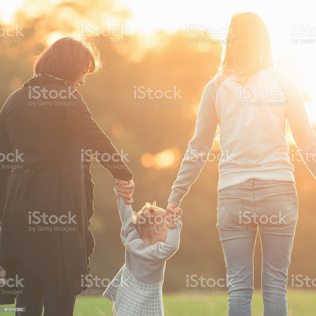 Happy family with mother, daughter and grandma outdoor. Fall season stock photo