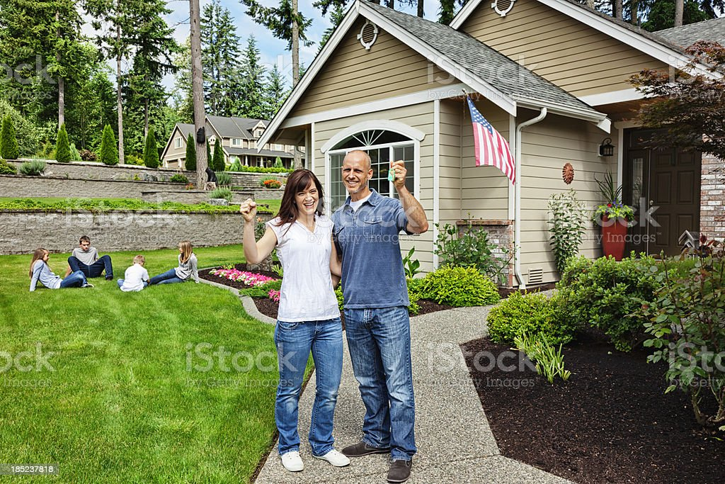 Happy Family with New Home stock photo