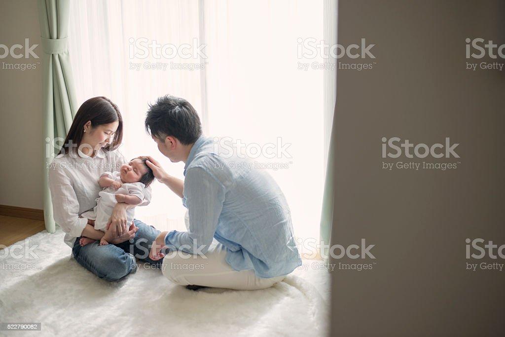 Happy family with newborn baby stock photo