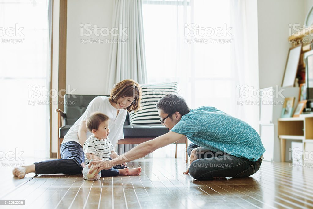 Happy family with newborn baby. stock photo