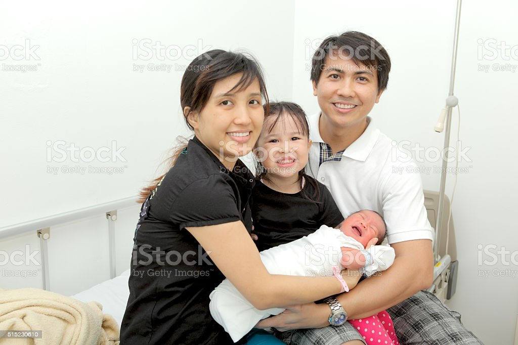 Happy Family With The Newborn Baby stock photo