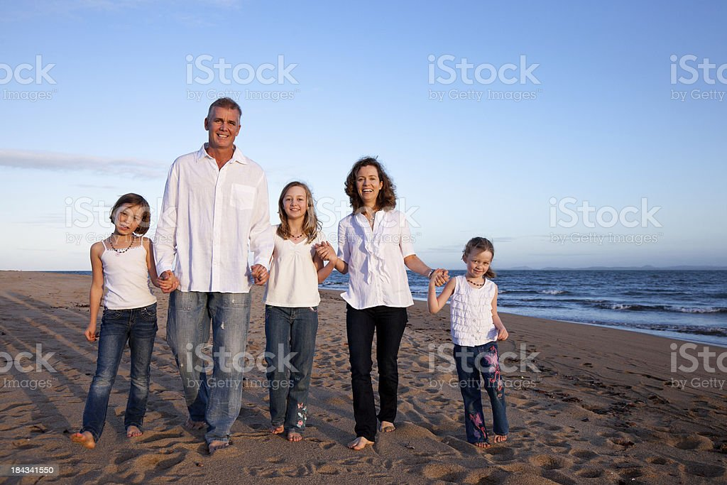 Happy Family with three children at beach with blue sky royalty-free stock photo