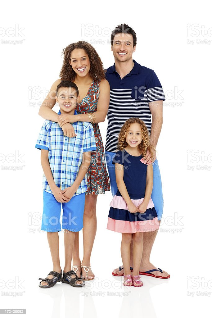 Happy family with two children standing togethe royalty-free stock photo