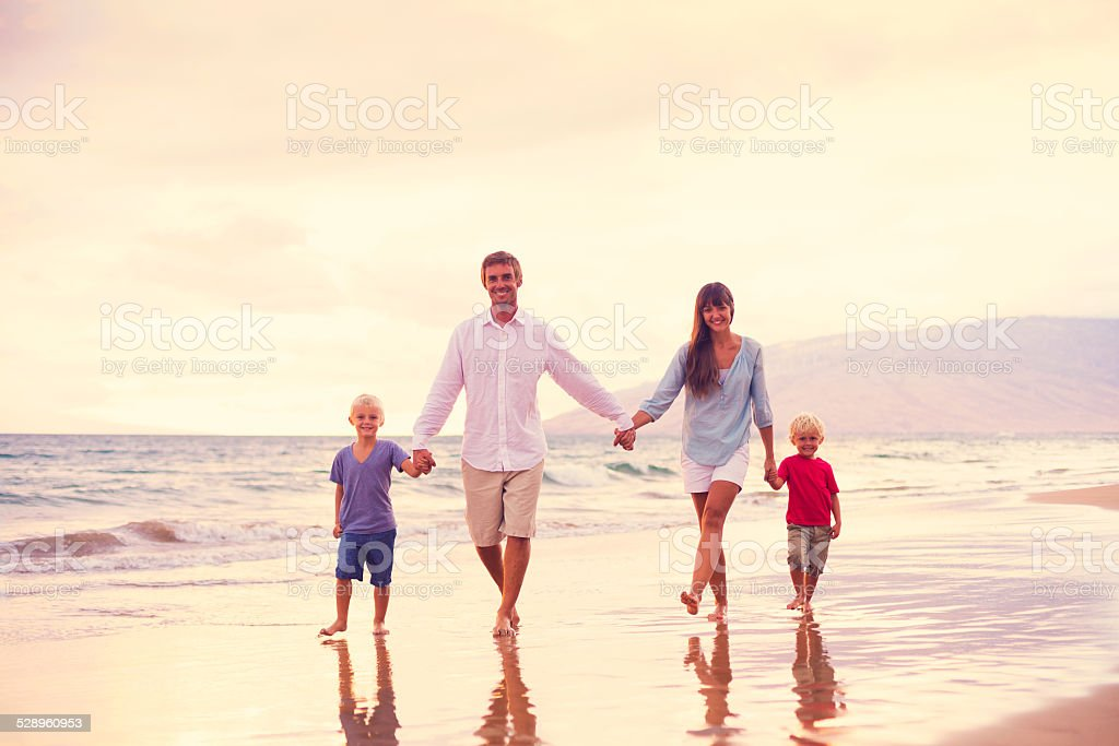 Happy Family with Two Young Kids stock photo