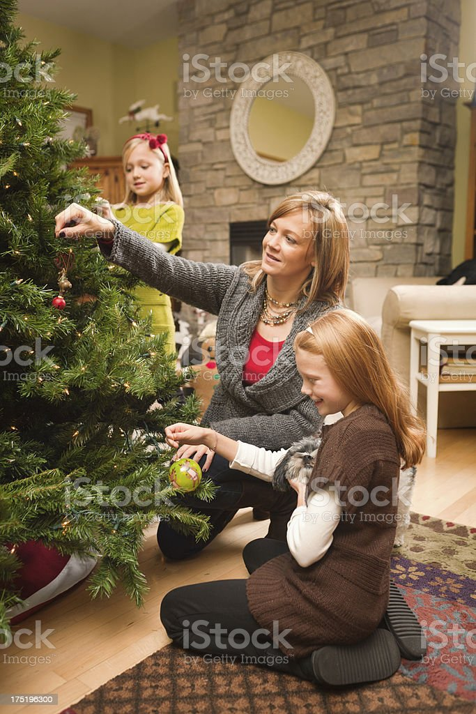 Happy Family Working Together Decorating Christmas Tree Vt royalty-free stock photo