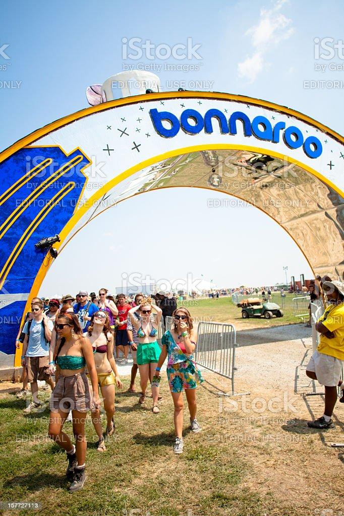 Happy fans entering through the Bonnaroo arch stock photo