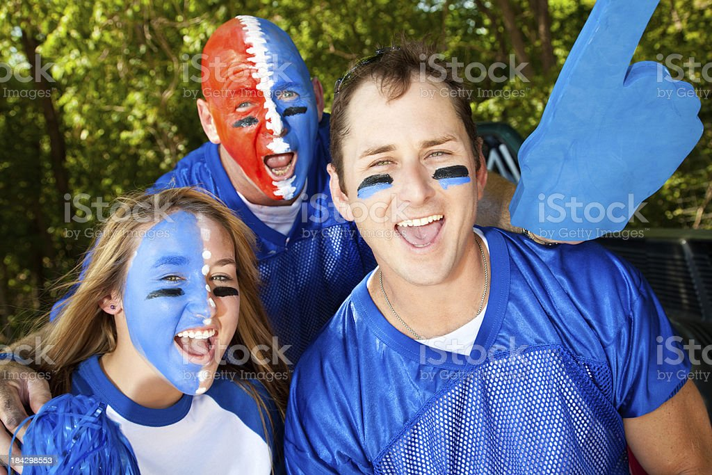 Happy Fans Yelling Together at Tailgate Party stock photo