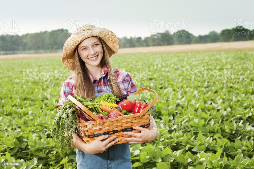 Happy Farm Girl with Basket of Fresh Produce Vegetables Hz royalty-free stock photo