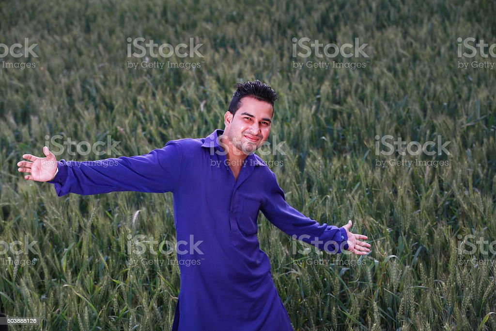 Happy farmer in his wheat field stock photo