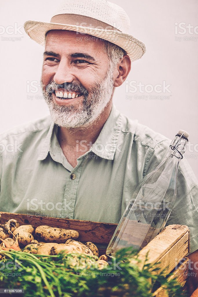 Happy Farmer Portrait with his Crops stock photo