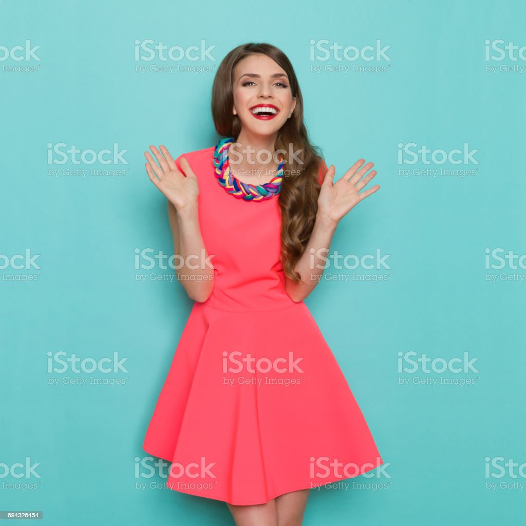 Happy Fashion Model With Hads Raised stock photo