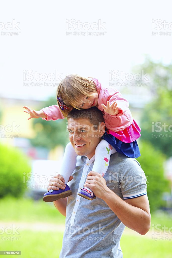 happy father and baby girl having fun outdoors stock photo