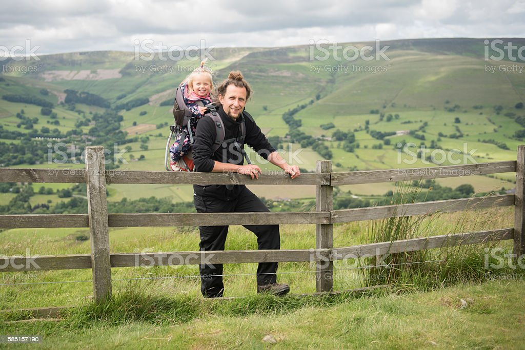 Happy father and daughter hiking stock photo
