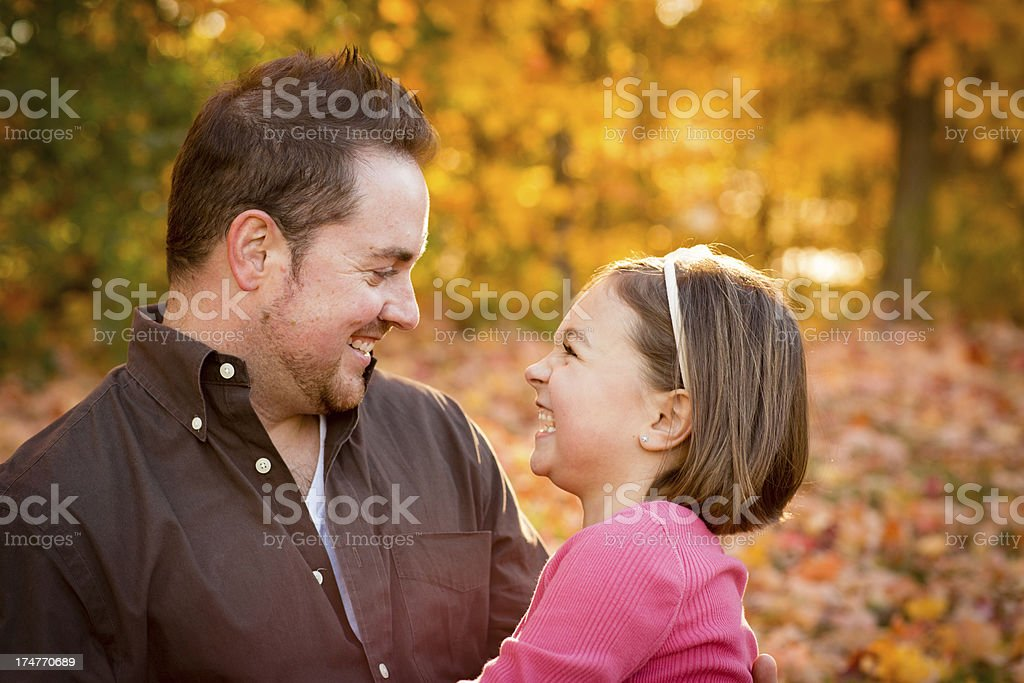 Happy Father and Daughter Laughing Outside on Beautiful Fall Day royalty-free stock photo