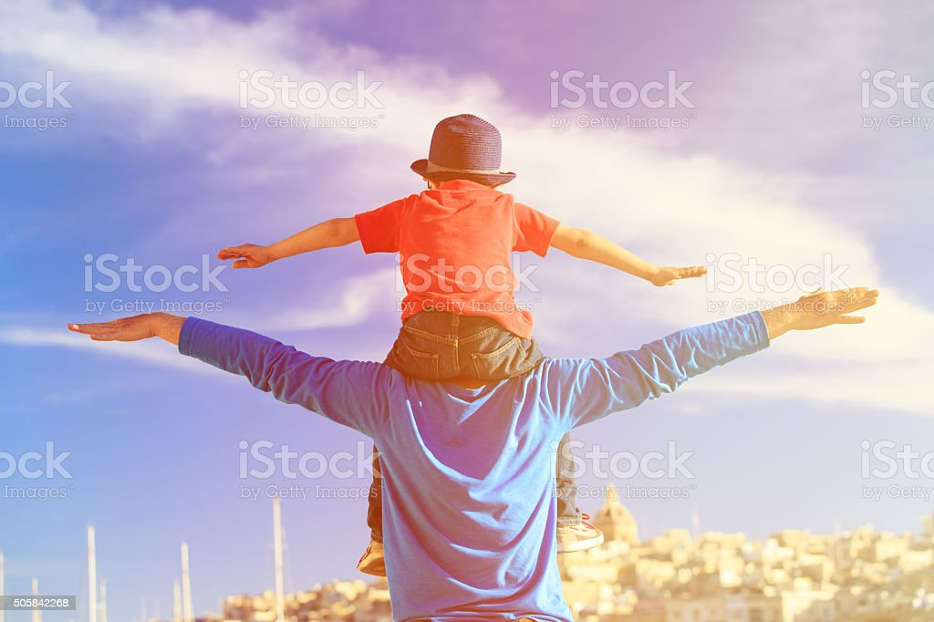 happy father and little son play on sky stock photo