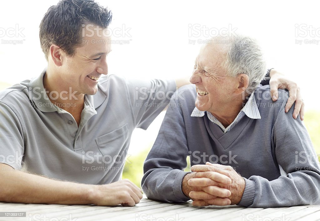 Happy father and son enjoying themselves stock photo