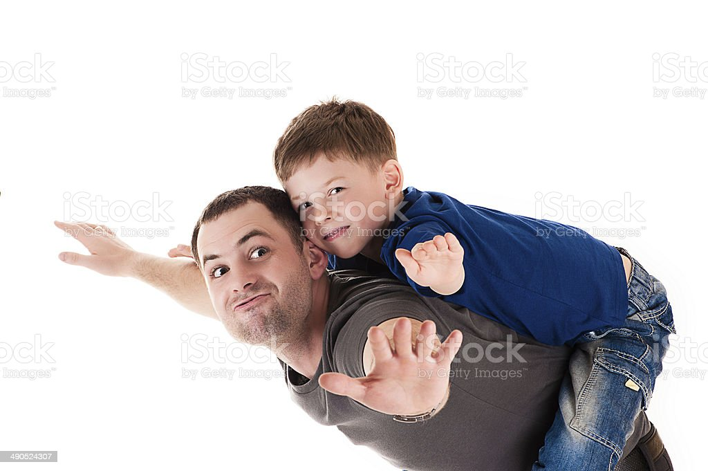 happy father and son flying stock photo
