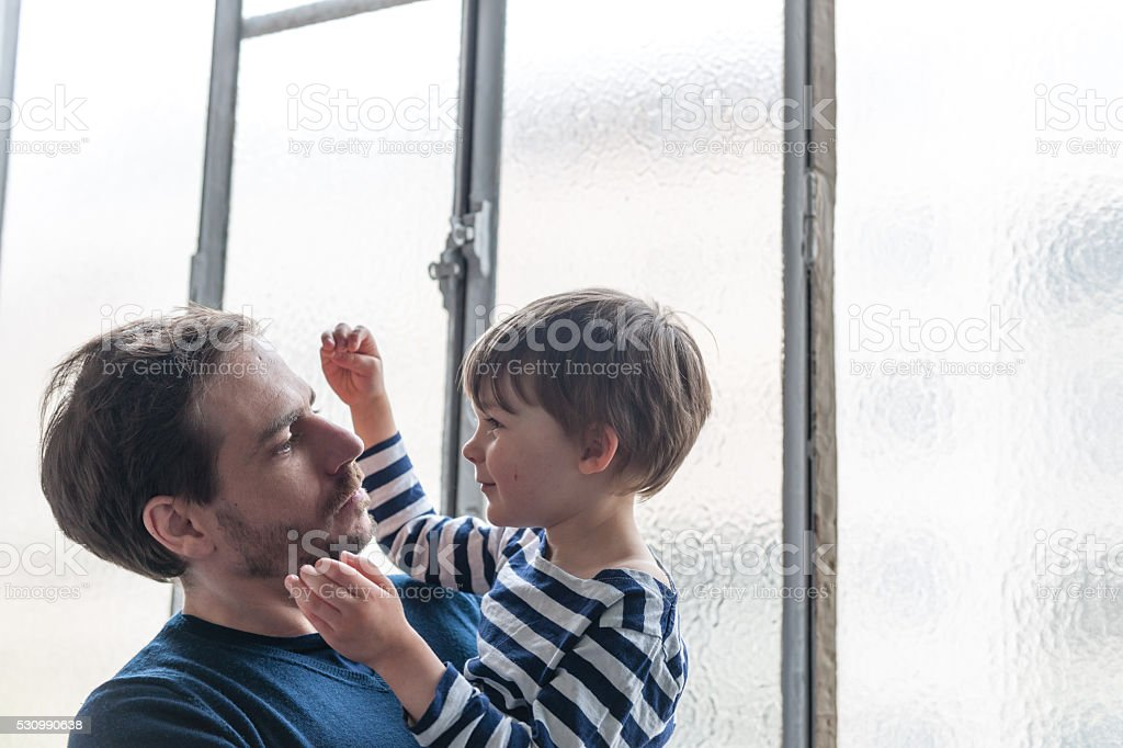 Happy Father and Son Together Playing, Paris, France stock photo