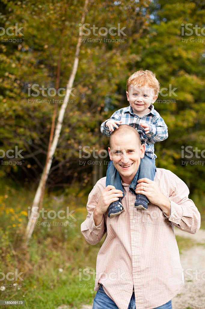 Happy Father Carrying His Son on Shoulders Outdoors royalty-free stock photo