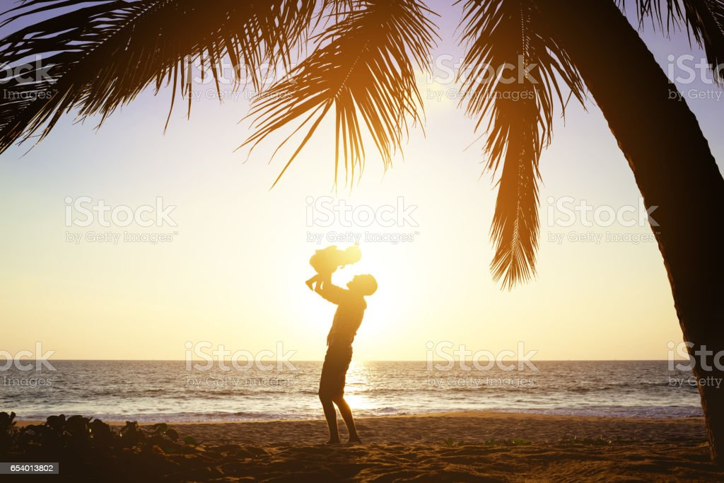 Happy father daughter fun sunset palms stock photo