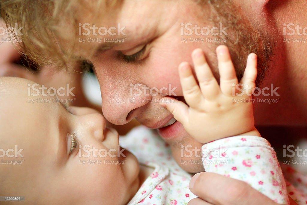 Happy Father Loving Newborn Baby Girl stock photo