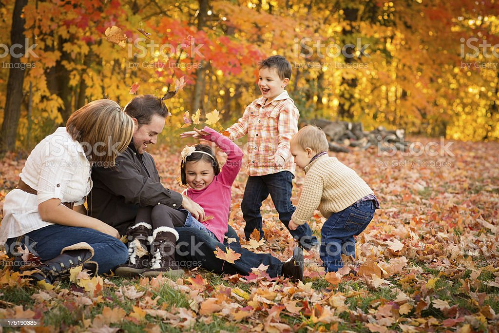 Happy Father, Mother, Daughter, and Sons Playing on Fall Day royalty-free stock photo