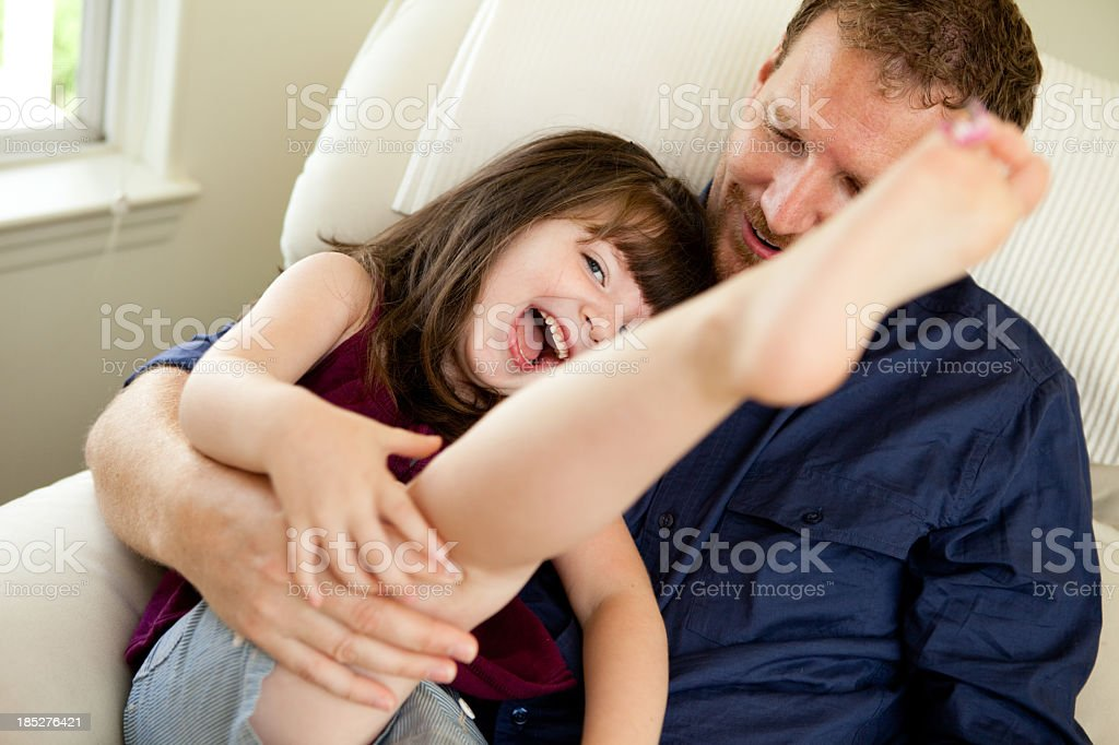 Happy Father Playing With Little Girl on His Lap royalty-free stock photo