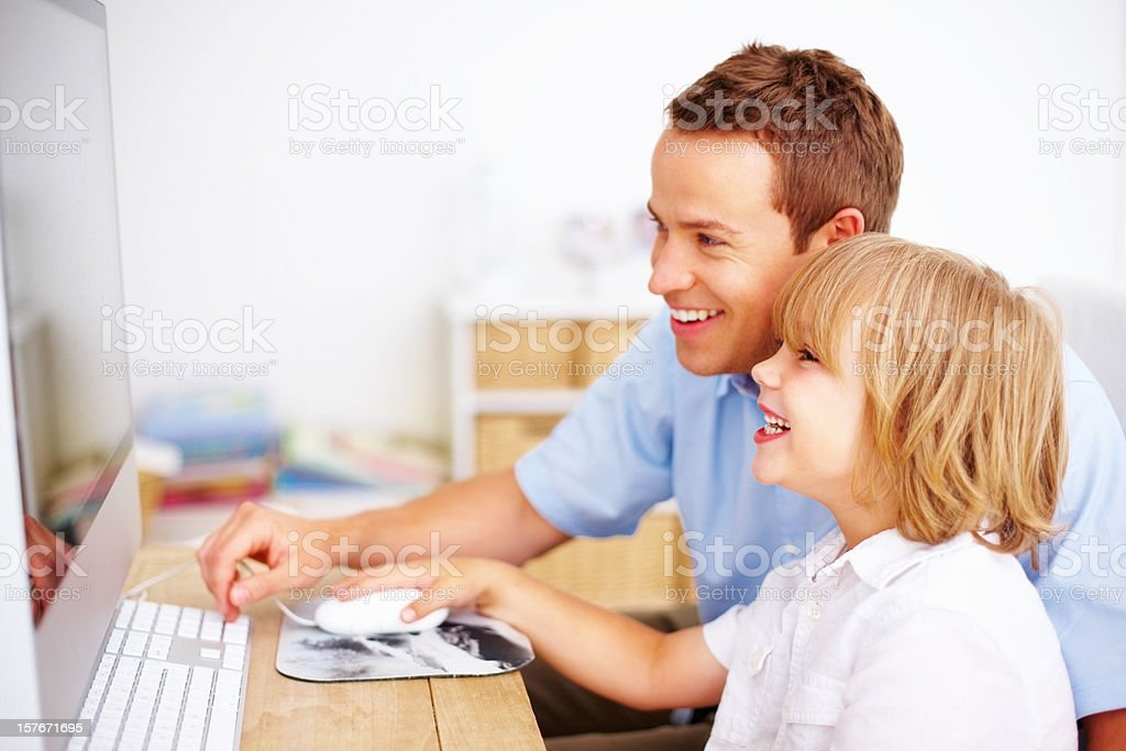 Happy father with his cute son looking at computer royalty-free stock photo