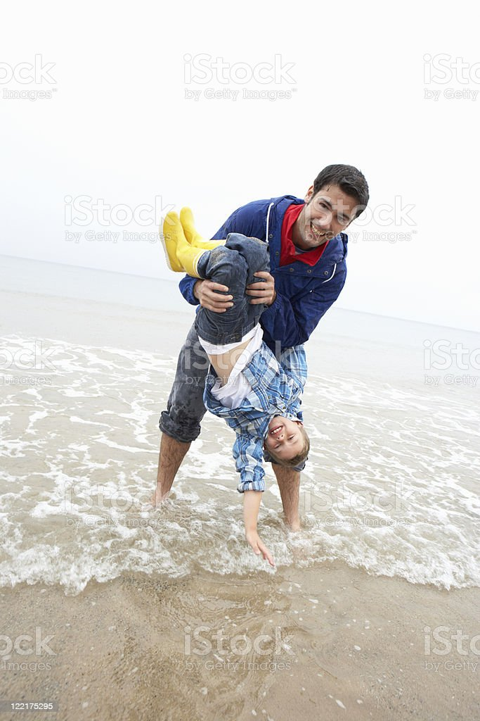 Happy father with son on beach royalty-free stock photo