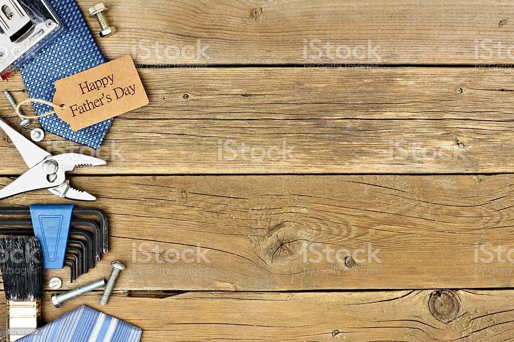 Happy Fathers Day gift tag with side border on wood stock photo