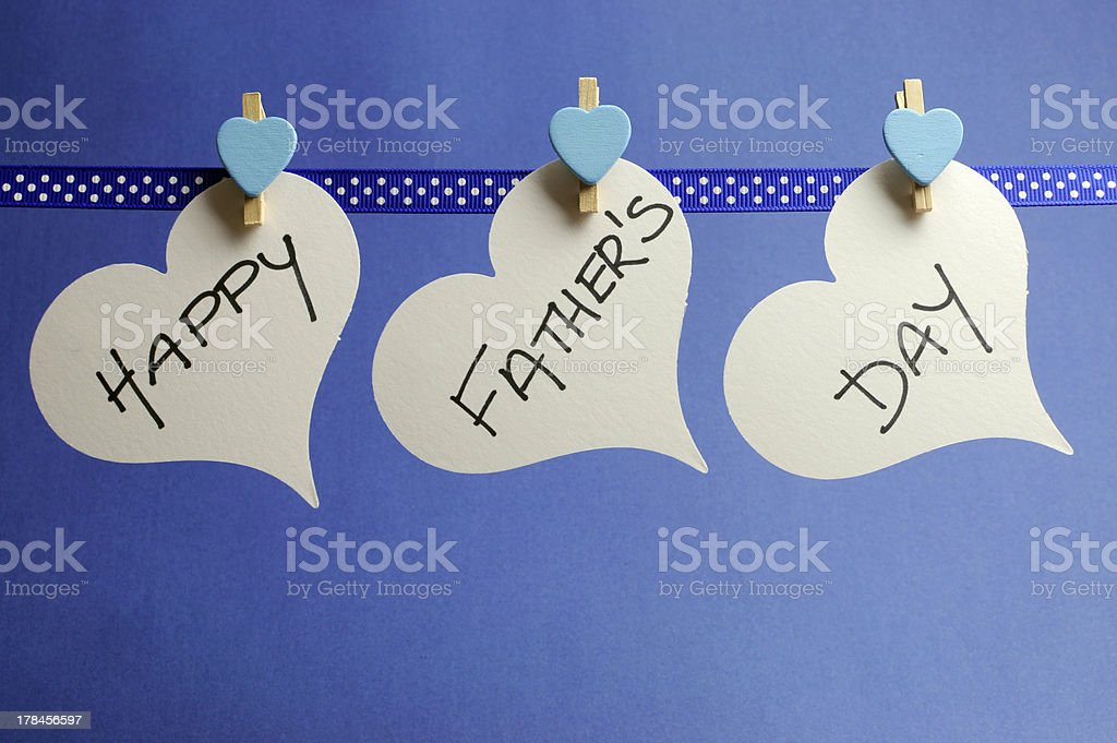 Happy Fathers Day hearts hanging pegs on a line. stock photo