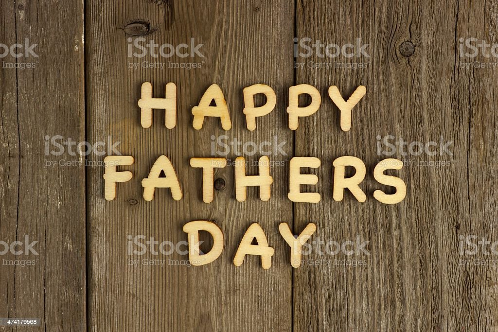 Happy Fathers Day message on wood stock photo