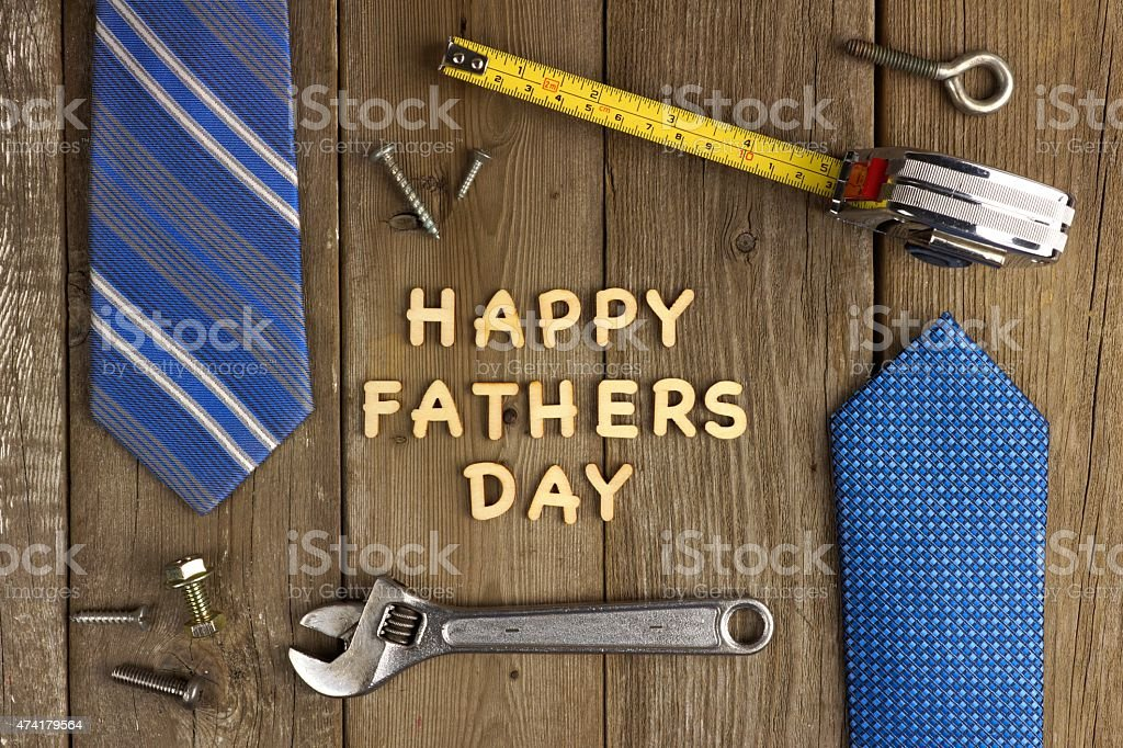 Happy Fathers Day on wood with tools and ties stock photo