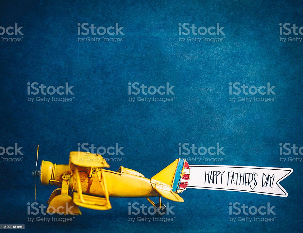 Happy Father's Day! Vintage airplane with handmade banner stock photo