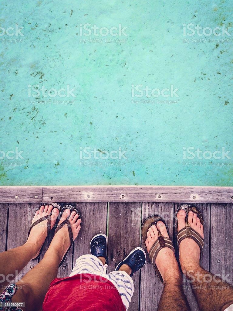 Happy feet family on the Maldives stock photo