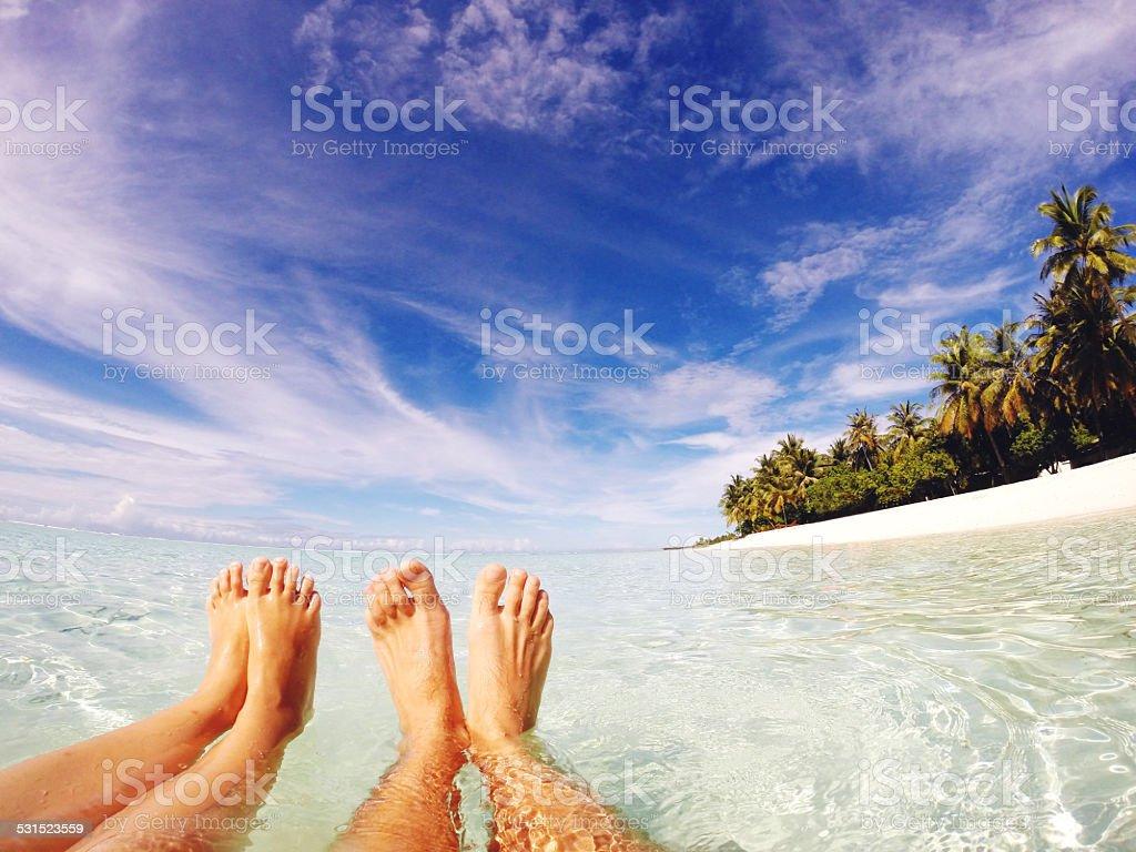 Happy feet in tropical paradise stock photo