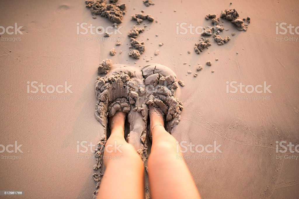Happy Feet -- Woman's feet playing in the sand stock photo