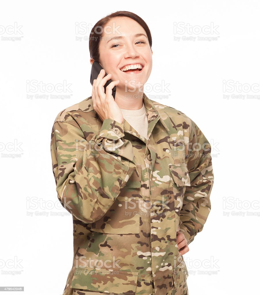 Happy female army soldier with phone. stock photo