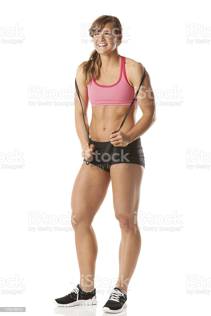 Happy female athlete with a jump rope royalty-free stock photo