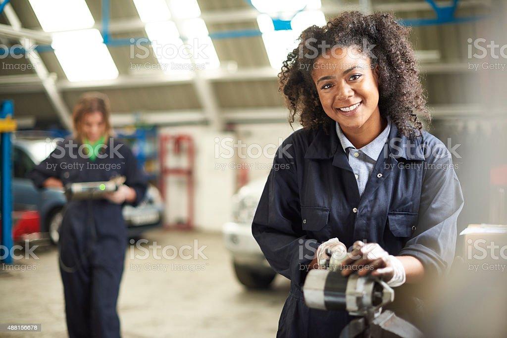 happy female auto mechanic stock photo