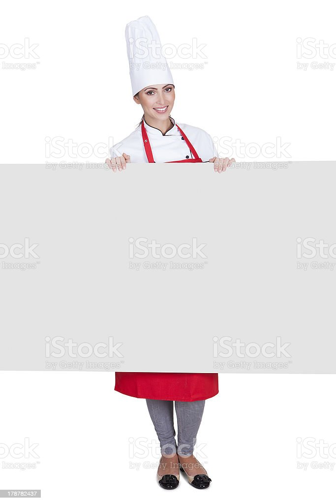 Happy Female Chef Holding Placard royalty-free stock photo