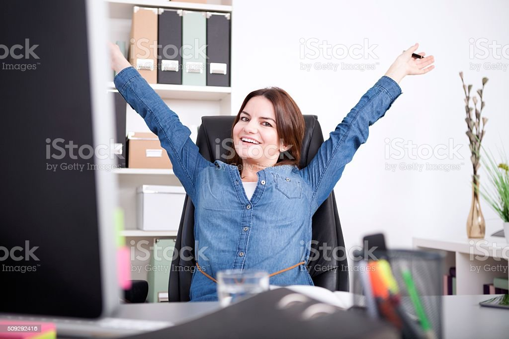 Happy Female Executive Stretching her Arms stock photo