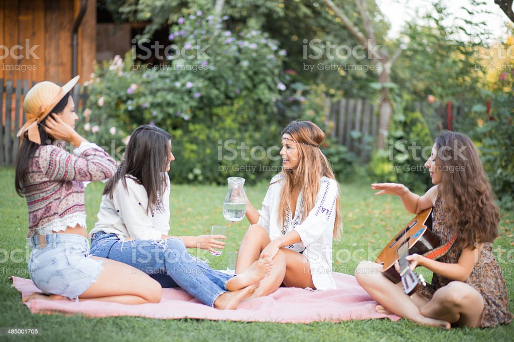 Happy female friends having fun outside in nature stock photo