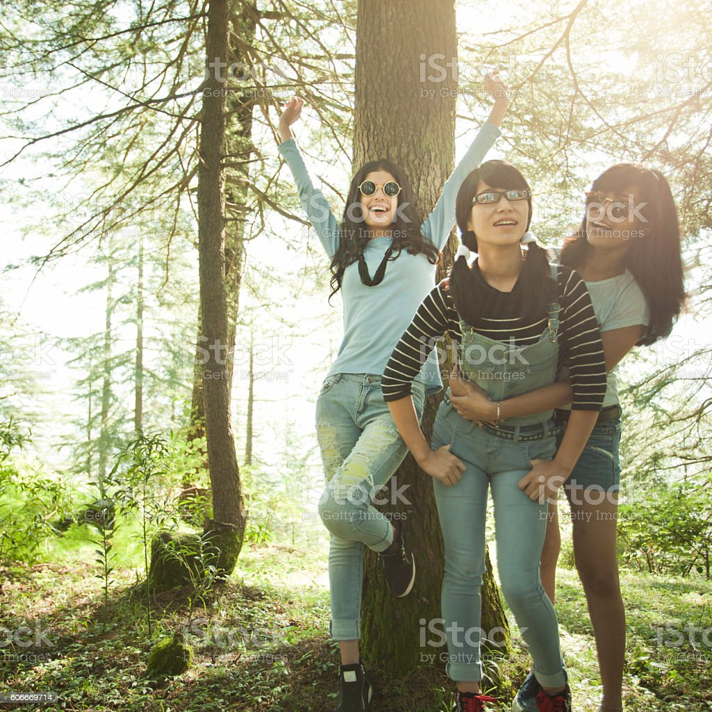 Happy female friends of different ethnicity doing fun in nature. stock photo