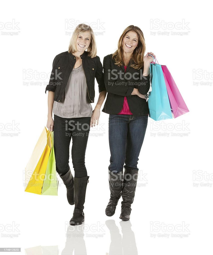 Happy female friends with shopping bags royalty-free stock photo