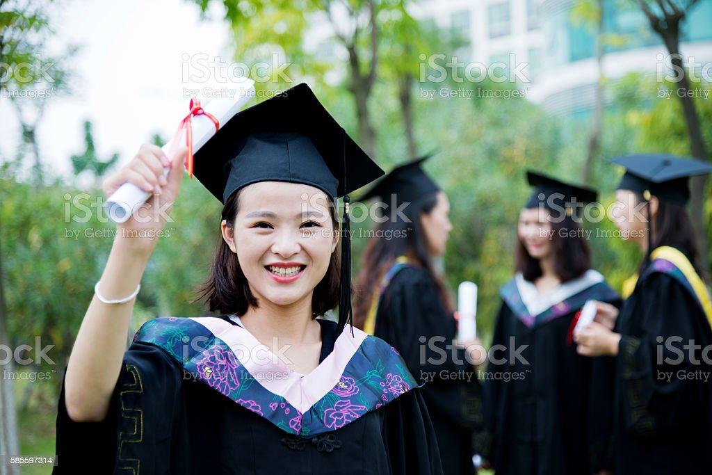 Happy female graduate stock photo
