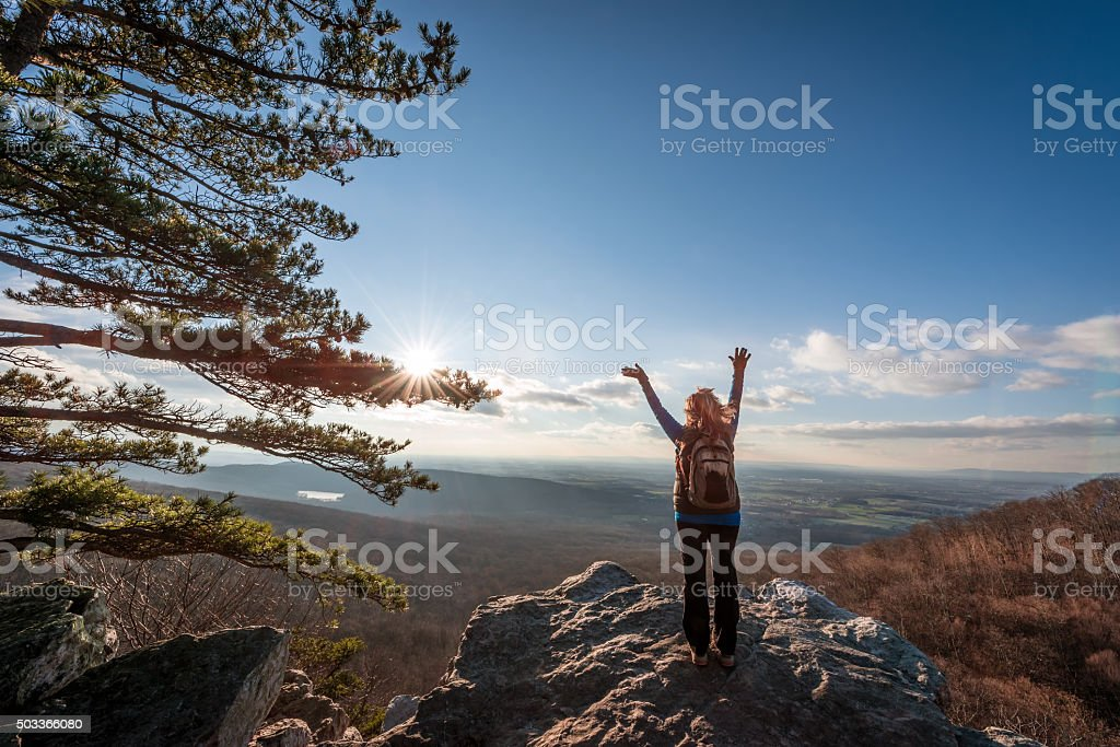 Happy female hikerat the summit of an Appalachian mountain stock photo
