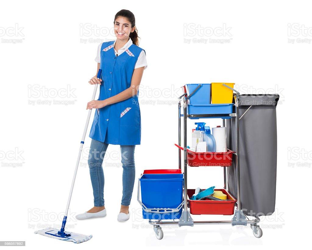 Happy Female Janitor Mopping By Trolley On White Background stock photo