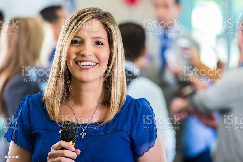 Happy female news reporter stock photo